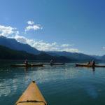 Fleet of Wooden Kayaks on the water